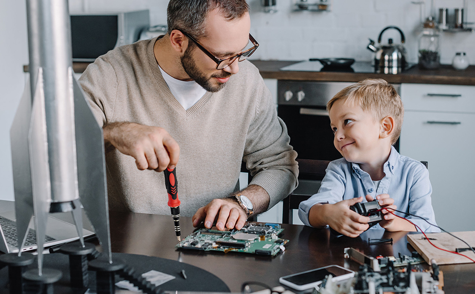 Dad and son use iPhone repair kit to repair their electronics.